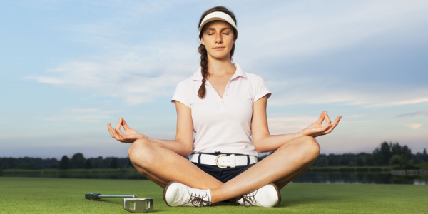 A Young Girl Get Relaxed Or Meditate With Golf Club And Ball In Golf Ground.